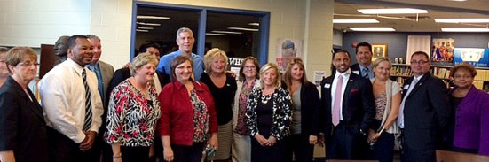 U.S. Secretary of Education Arne Duncan (center) visits with Northwest Ohio principals and teachers.